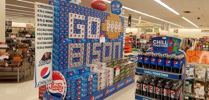 Local man promotes school spirit with pop display